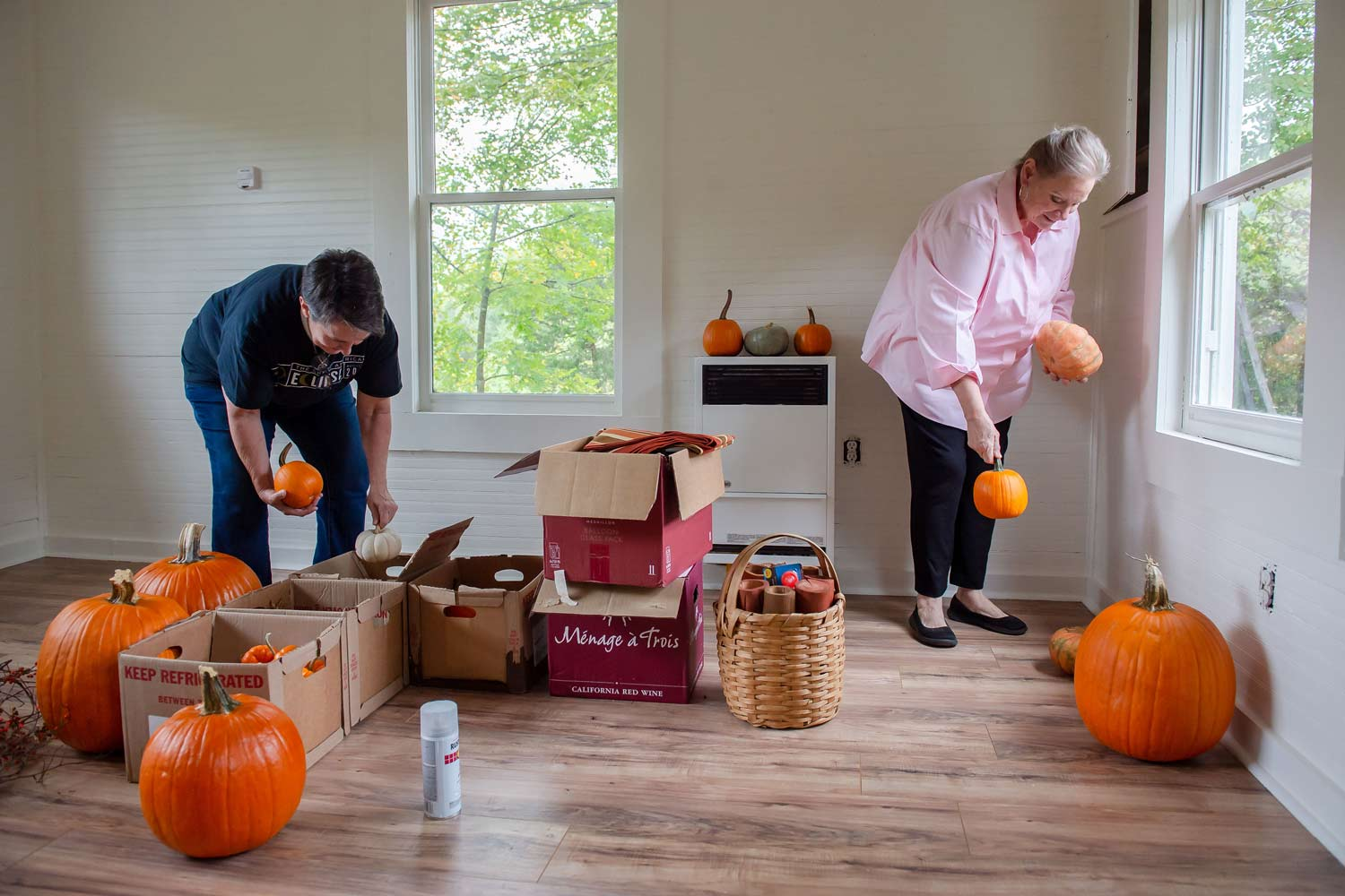 Becky Hoover and Paula Jones sort pumpkins to be used for decor for an upcoming wedding at the Parker Ranch. Photography by Bita Honarvar.